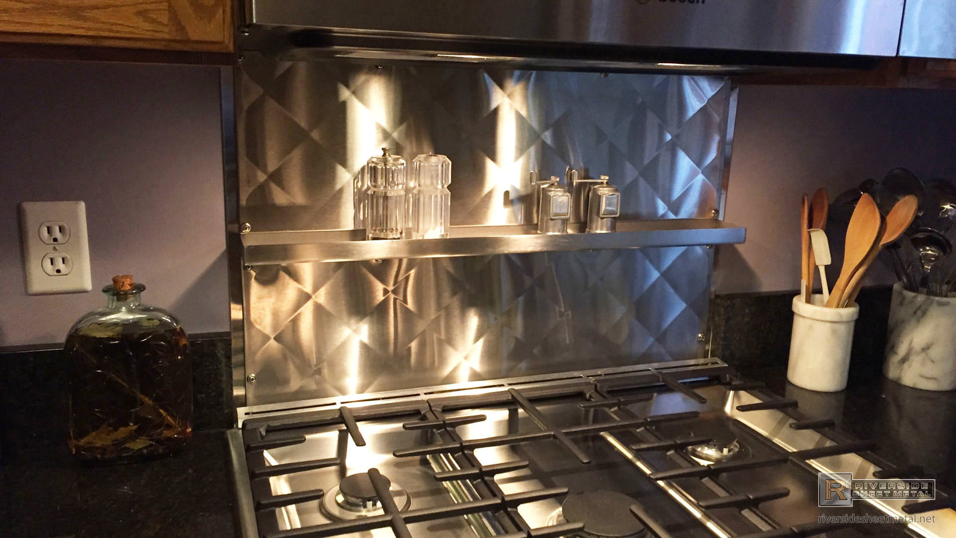 quilted back splash in stainless steel with shelf view 1