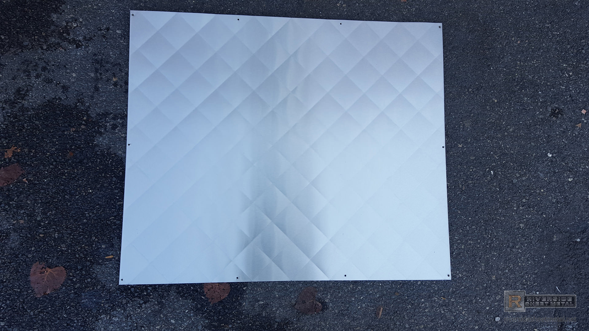 Quilted - Diamond pattern quilted stainless steel backsplash