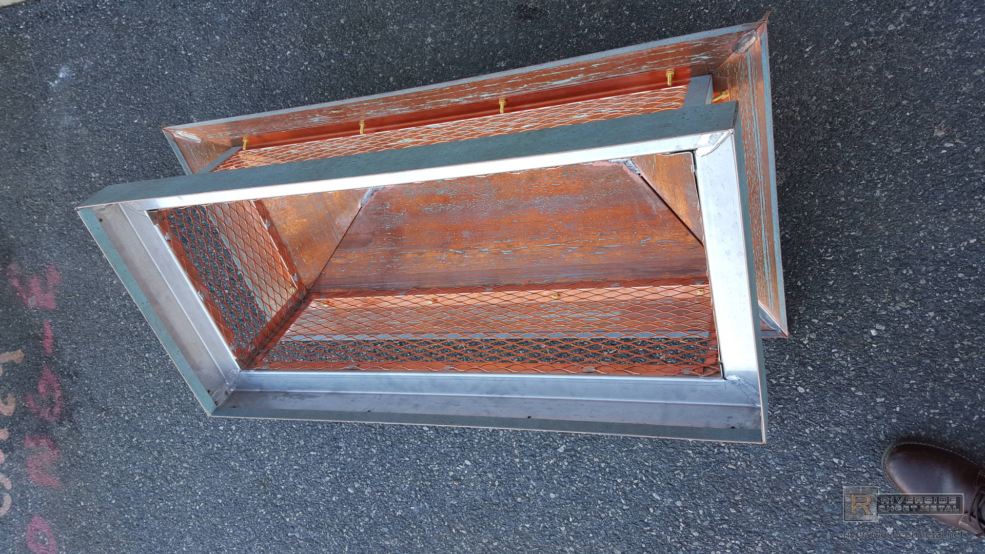 Copper Chimney Cap With Standing Seam Panels On A Hip Roof