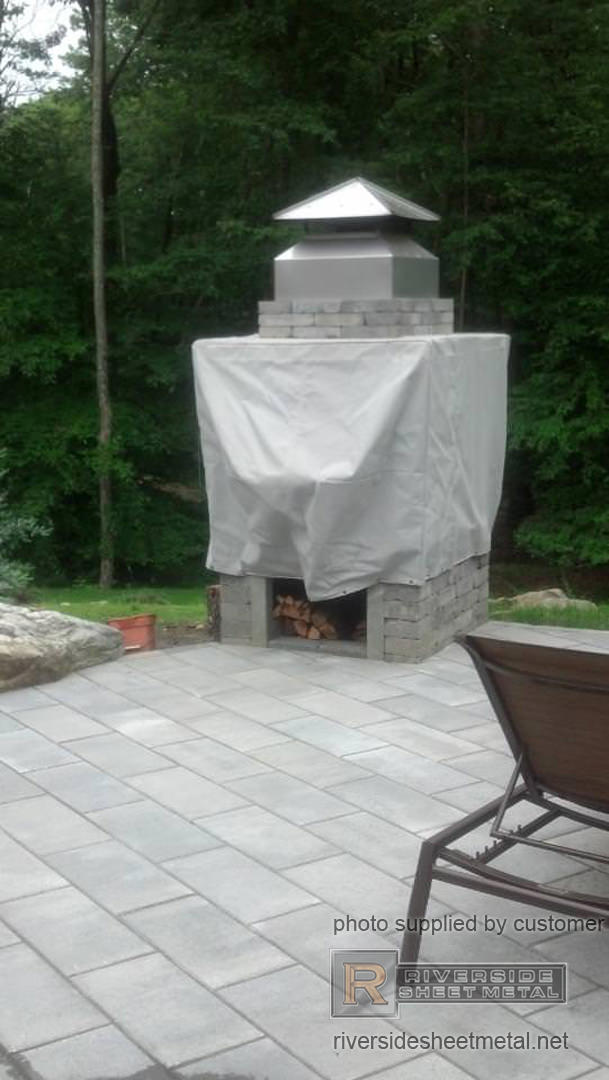 Angled Copper Chimney Cap With Standing Seam Panels On A