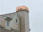 CH027 custom copper chimney shroud with standing seam panels - installation view 1