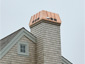 CH027 custom copper chimney shroud with standing seam panels - installation view 2