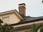 CH028 Custom 2 stage protection copper chimney cap with standard angled roof - installation photo - view 1