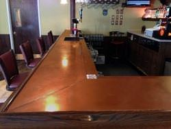 Copper bar top with wooden arm molding rest