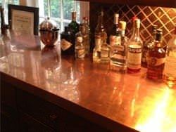 Copper counter top with liquor bottles look