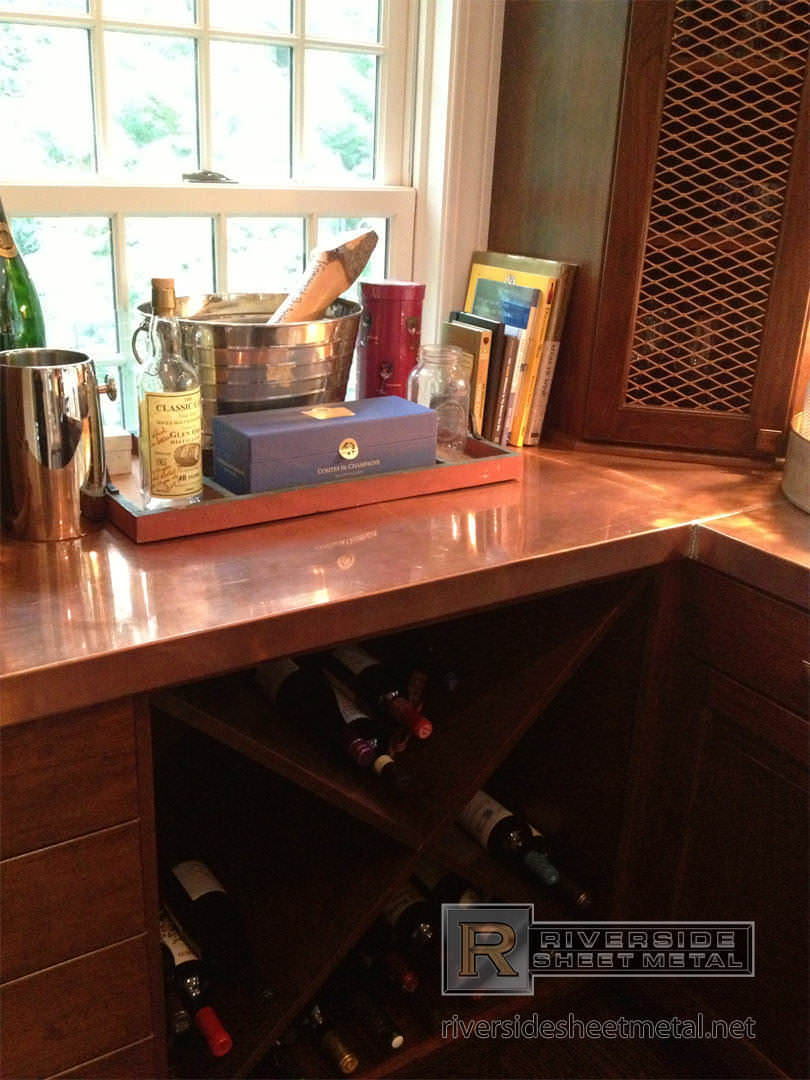 Copper Counter Top With Liquor Bottles Look Riverside