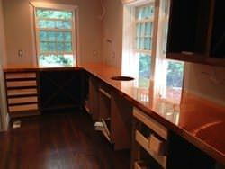 Copper counter top with round hammered sink installation