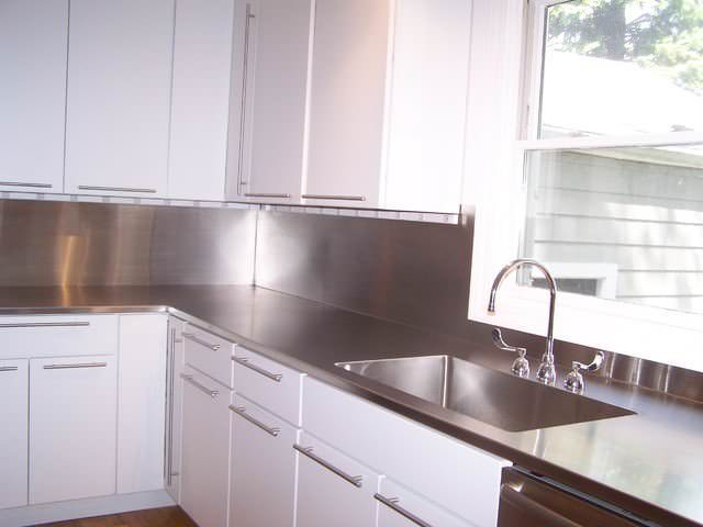 4 finish counter top with high backsplash and integrated sink