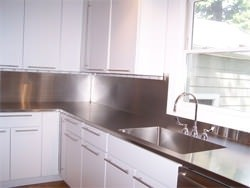 Stainless steel #4 finish counter top with high backsplash and integrated sink