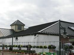 Bronze aluminum cupola on metal roof