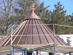 Copper roof with finial installed on
