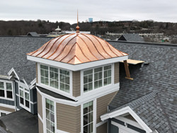 Copper cupola tower - eyebrow roof with finial