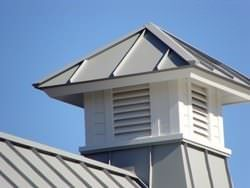 Gray aluminum cupola on metal roof