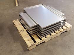 Stainless steel drip pans in fabrication
