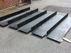 Custom blackened steel plates after