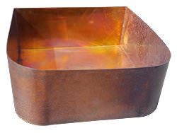 Custom copper sink over wooden cabinet