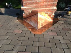 Copper cricket installation on chimney