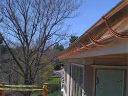 Half round copper gutter installation with undermount hangers