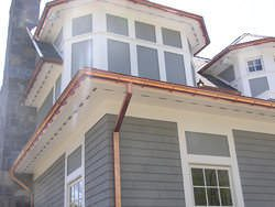 Half-round gutters with undermount hangers
