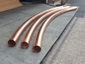 Custom plain round radius copper downspouts - view 1