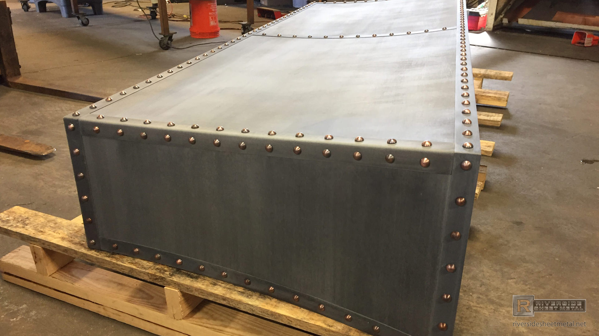 custom fireplace hood fabricated with zinc and copper rivets