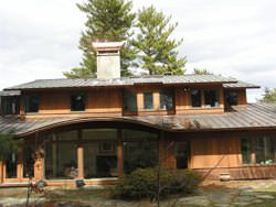 Flat lock panels and standing seam panels with chimney cap