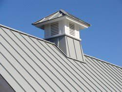 Gray aluminum roof with cupola detail