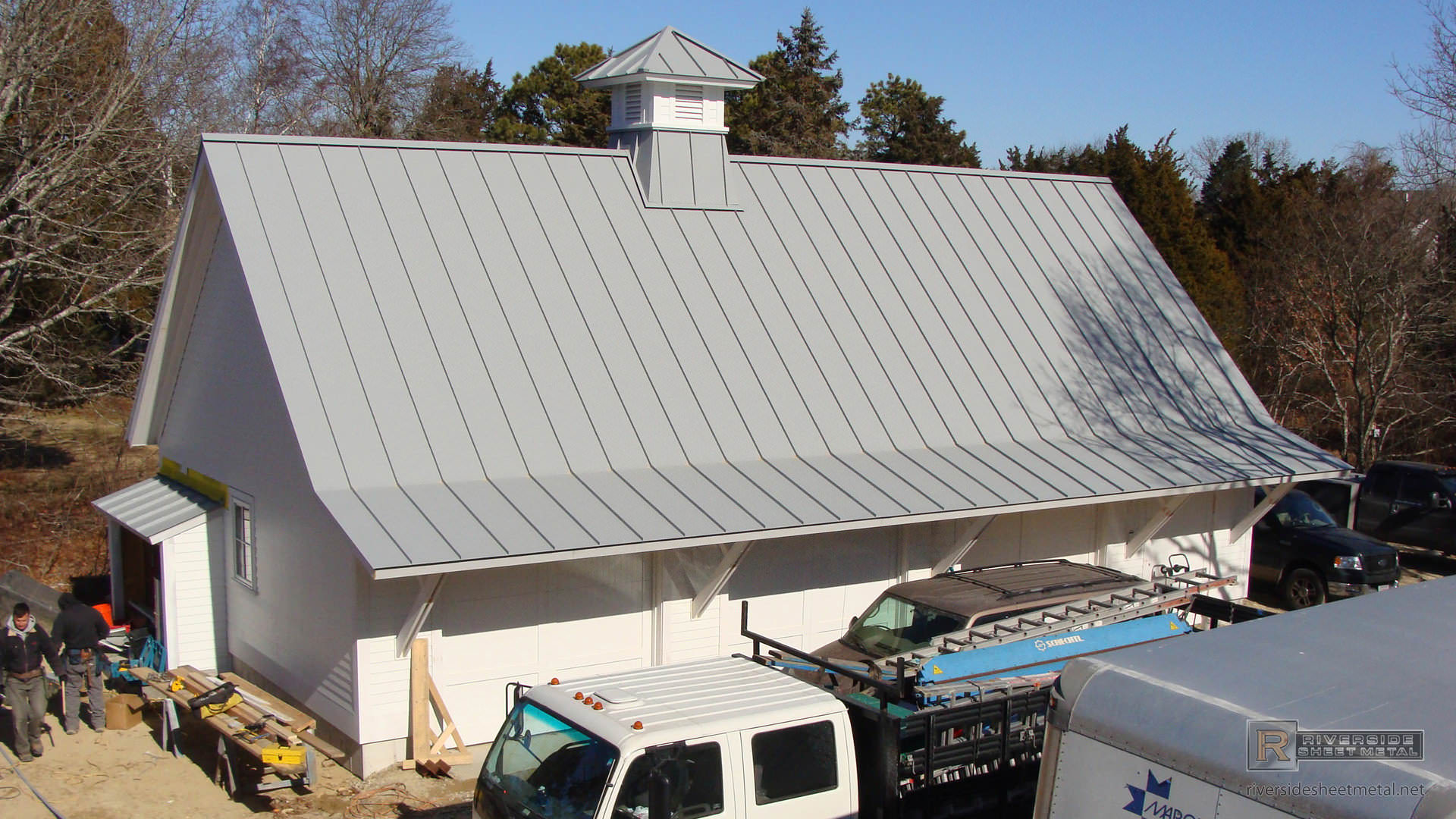 Dove Gray Aluminum Roof Angled With Solar Panels Installed