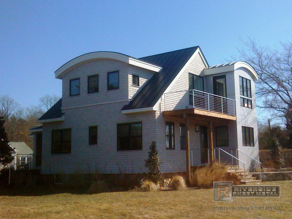 Charcoal gray metal roofing with radius panels - Medford