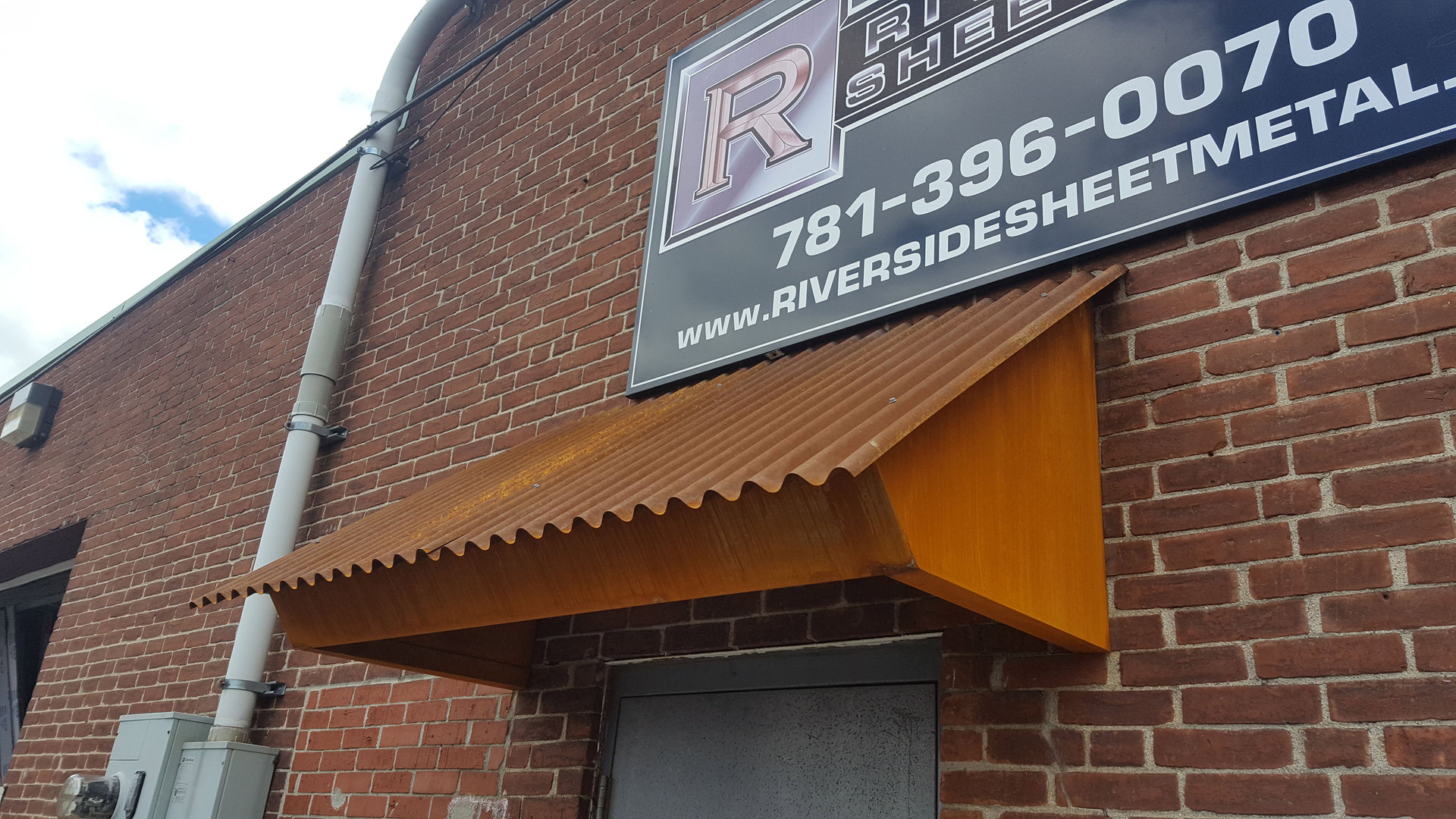 Corrugated Corten Rusted Roof Panel Installation