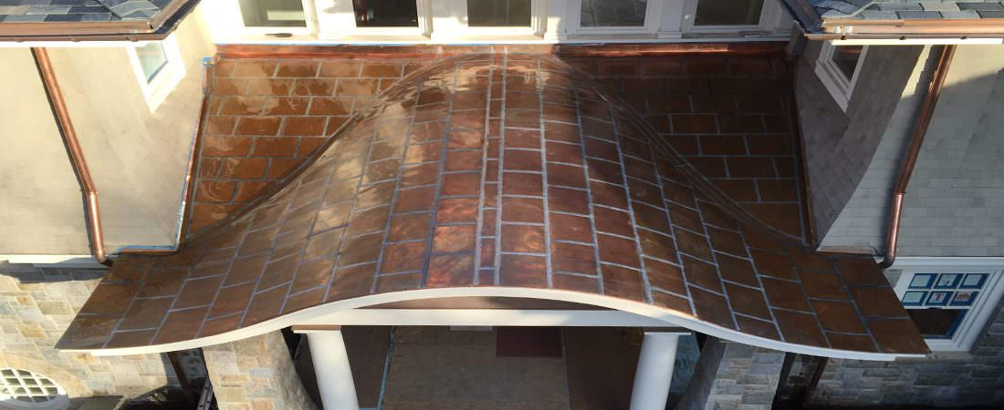 Flat locked roof panel installation