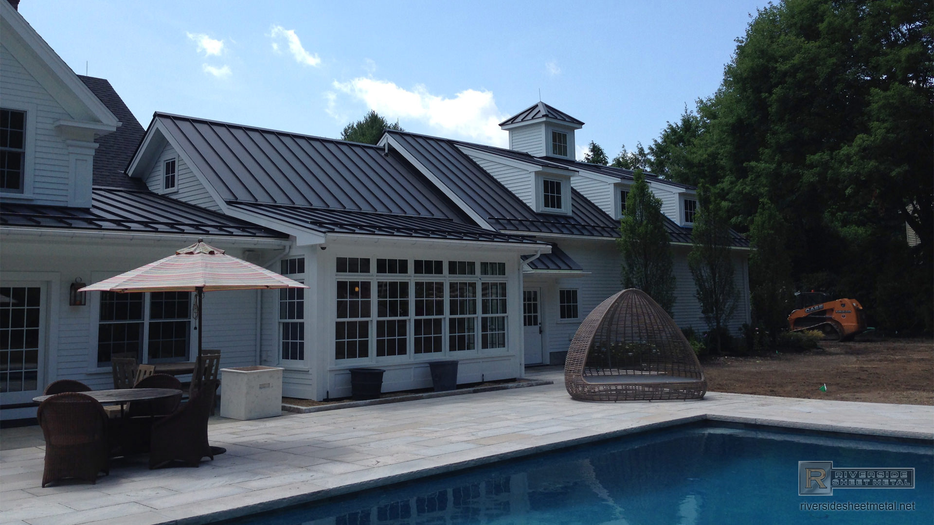 Matte black aluminum roofing with colorgard snow retention system