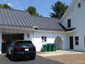 Standing seam matte black aluminum roofing with colorgard snow retention system and single bead gutter - view 3