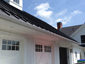 Standing seam matte black aluminum roofing with colorgard snow retention system and single bead gutter - view 7