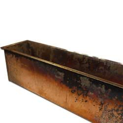 Burnished look detail on a copper planter