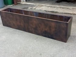 Flower box with custom dark patina finish applied