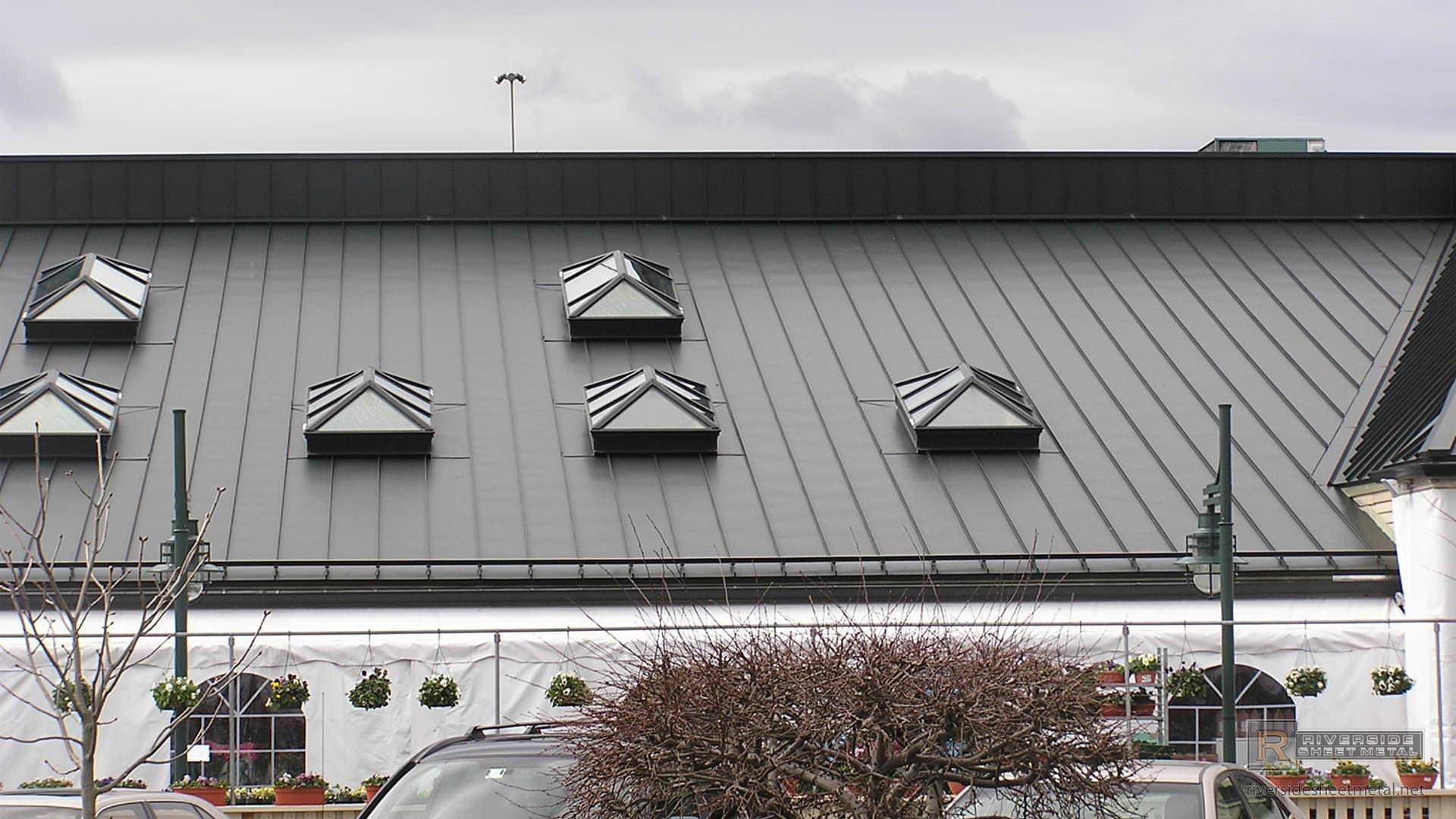 Bronze Aluminum Skylights On A Standing Seam Metal Roof