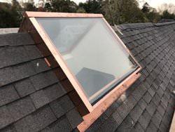 Custom made copper skylight on roof ridge