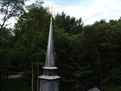 Copper squash player weathervane steeple installation - view 2